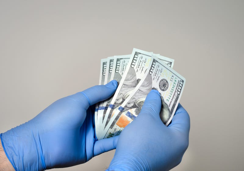 gloved hand counting american money