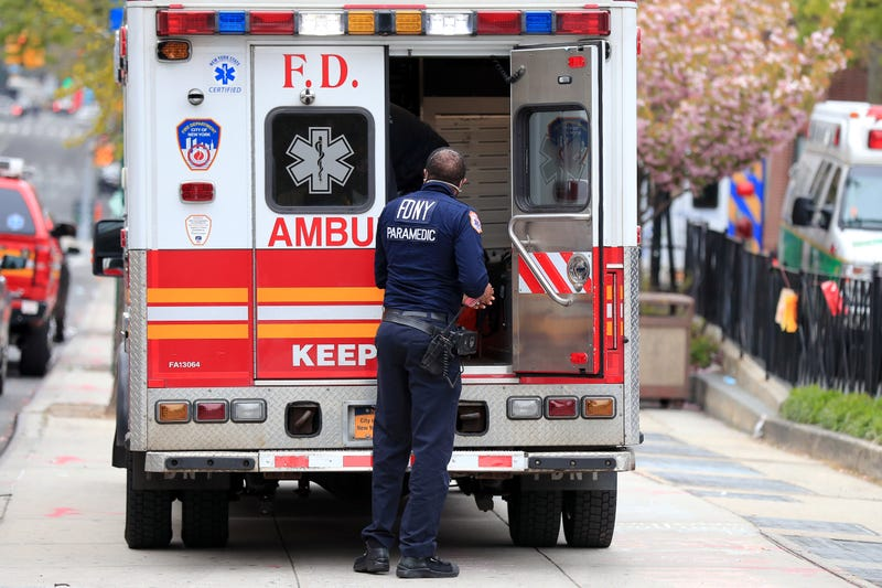 An FDNY paramedic unloads a patient from an ambulance near the Emergency Room entrance to the Brooklyn Hospital Center