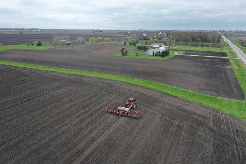 An aerial view from a drone shows John Duffy planting corn on a farm he farms with his father on April 23, 2020 near Dwight, Illinois.
