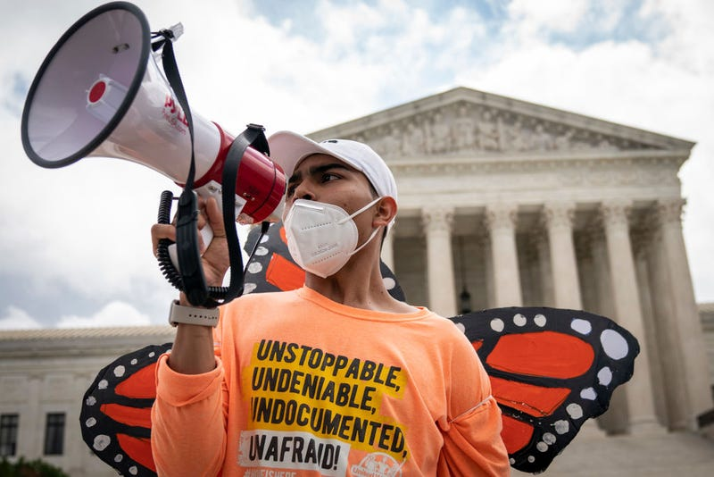 Roberto Martinez, a DACA recipient, chants and cheers following the Supreme Court's decision regarding the Trump administration's attempt to end DACA outside the U.S. Supreme Court on June 18, 2020 in Washington, DC.