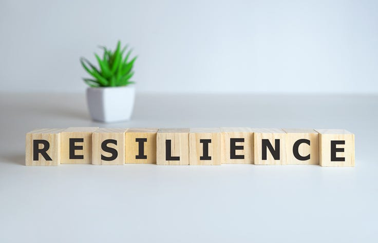 Resilience word concept on cubes