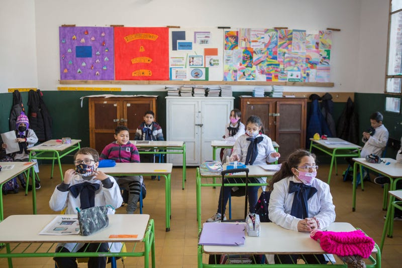 """Students at the """"Japon"""" public school number 72 attend class during the first day of the final phase of the gradual process to reopen schools on June 28, 2020 in Montevideo, Uruguay. Schools will impose strict social distancing measures and assistance is voluntary. Department of Treinta y Tres and border city of Rivera, postponed the return to school due to recent positive cases."""