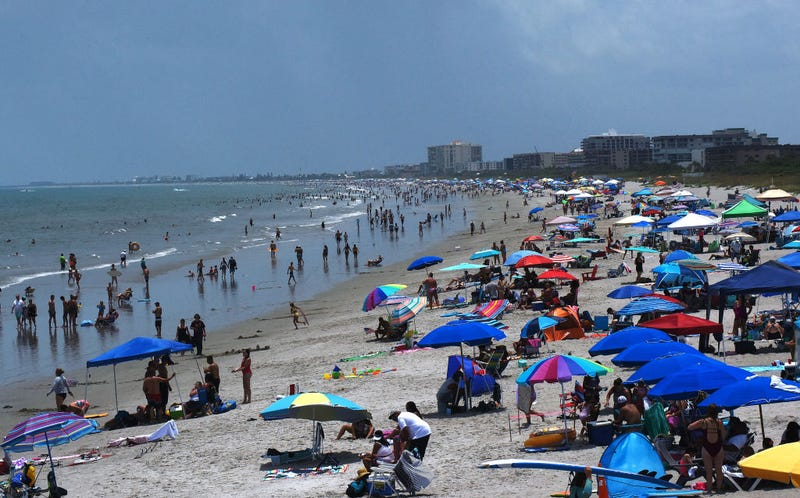 Beachgoers celebrate Independence Day on July 4th in Cocoa Beach, Florida