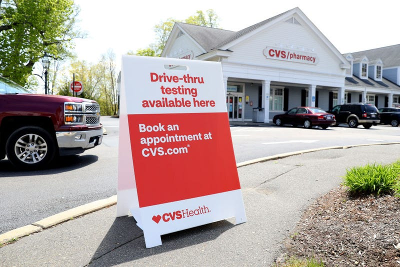 A sign promoting drive-thru coronavirus (COVID-19) tests at CVS Pharmacy on May 15, 2020 in Bridgewater, Massachusetts. Nine CVS locations began providing coronavirus tests in Massachusetts, issuing self swab tests to people by appointment.