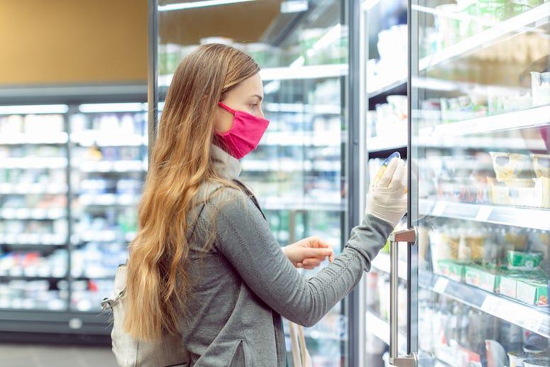 Woman wearing mask while shopping