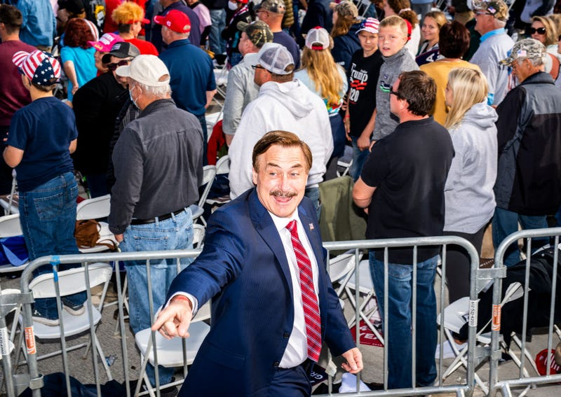 Mike Lindell (L), founder of My Pillow Inc., points to the crowd during a rally for President Donald Trump at the Bemidji Regional Airport on September 18, 2020 in Bemidji, Minnesota.