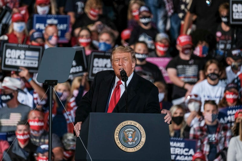 President Donald Trump addresses the crowd during a campaign event at the Toledo Express Airport in Swanton, Ohio on Monday