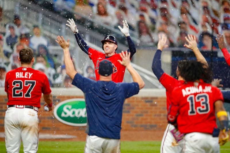 Freddie Freeman celebrates with teammates after beating the Red Sox on a walk-off home run