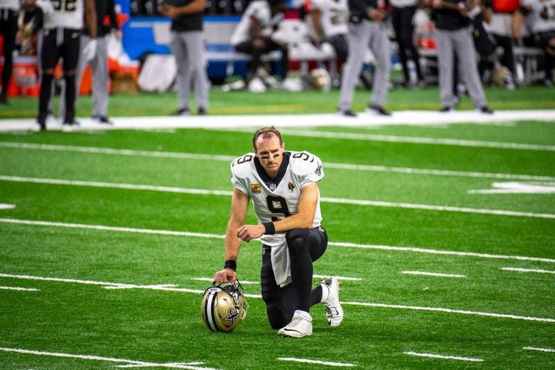 Drew Brees take a knee during the Saints' Week 4 game against the Lions
