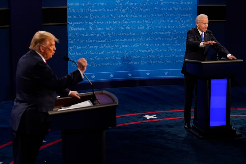 Democratic presidential candidate former Vice President Joe Biden answers a question as President Donald Trump listens during the second and final presidential debate at Belmont University on October 22, 2020 in Nashville, Tennessee.