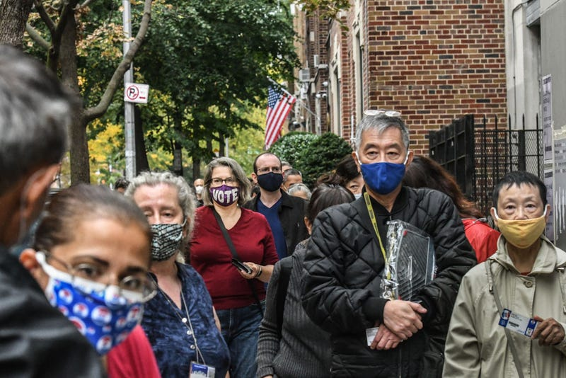 People wait in a line to vote at the Queens Public Library during early voting for the U.S. Presidential election on October 24, 2020 in the Jackson Heights neighborhood in the Queens borough in New York City. Due to the coronavirus and social distancing concerns New York State is allowing early voting for the first time.