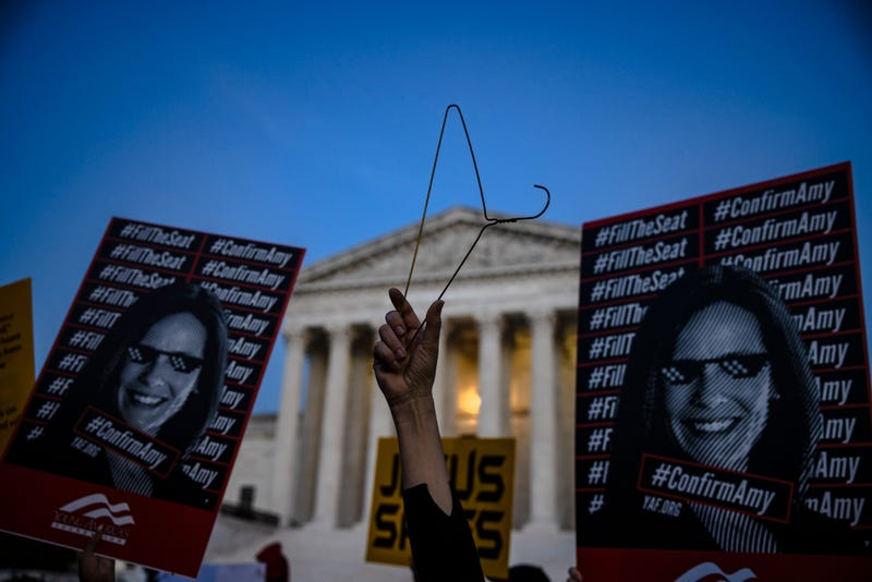 People that both support and oppose the nomination of Judge Amy Coney Barrett demonstrate in front of the Supreme Court of the United States on October 26, 2020 in Washington, DC. It is expected that the Senate will vote on the nomination of Judge Amy Coney Barrett to be an Associate Justice of the Supreme Court later in the day.