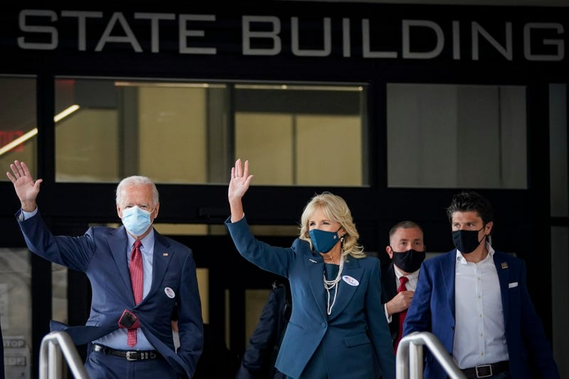 Democratic presidential candidate Joe Biden and his wife Dr. Jill Biden depart the Delaware State Building after casting their ballots for the general election on October 28, 2020 in Wilmington, Delaware.
