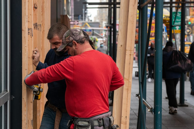 Carpenters board up a Forever 21 store in Times Square on November 1, 2020 in New York City.