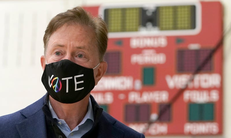 Connecticut Governor Ned Lamont prepares to cast his vote at Greenwich High School in Greenwich, Connecticut, on November 3, 2020.