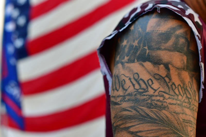 "A tattoo reads ""We the People"""