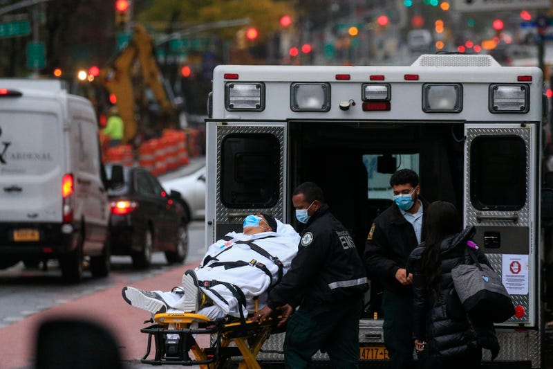 A patient is transported outside of Tisch Hospital in New York on November 13, 2020.