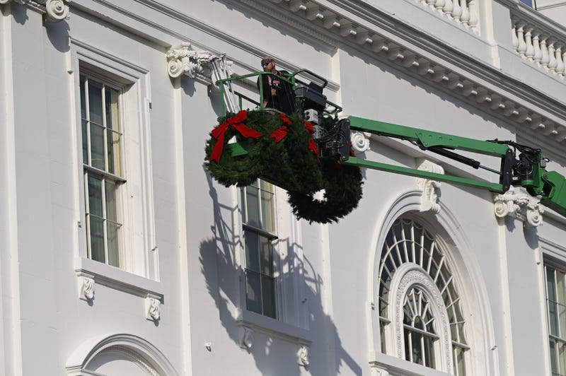 Christmas wreaths are installed at the White House in Washington, DC, on November 21, 2020.