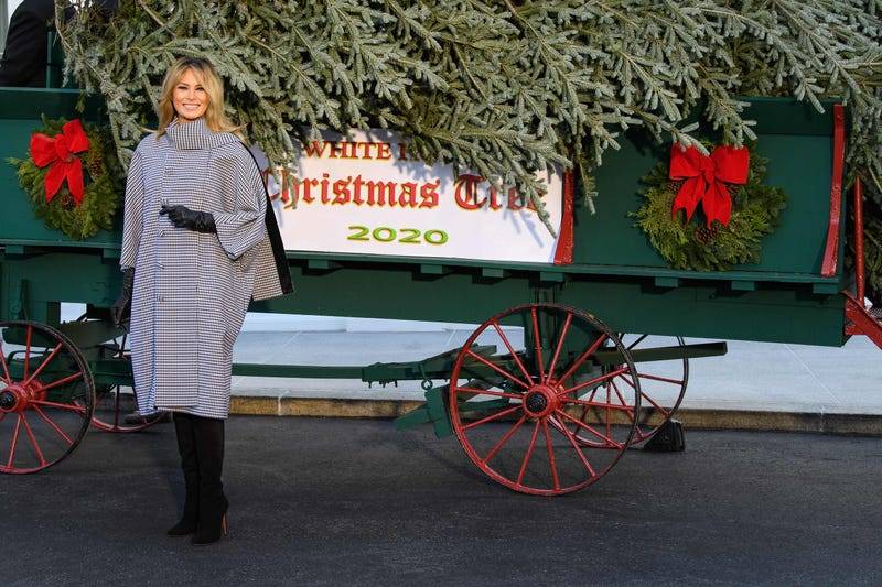 U.S. first lady Melania Trump waves as she receives the 2020 White House Christmas Tree November 23, 2020 at the White House in Washington, DC. The 18 foot tall Fraser Fir from West Virginia will be decorated and displayed in the Blue Room of the White House for this holiday season.