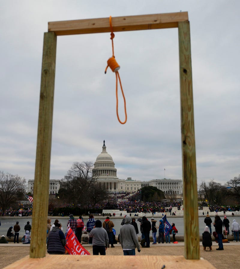 A noose is seen on makeshift gallows as supporters of US President Donald Trump gather on the West side of the US Capitol in Washington DC on January 6, 2021.