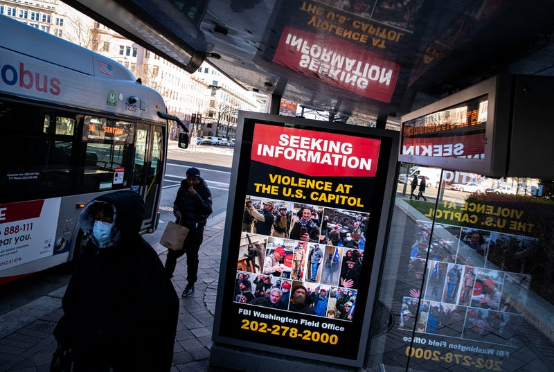 A billboard on a bus stop on Pennsylvania Avenue Northwest advertises a message from the Federal Bureau of Investigation seeking information related to violence at the U.S. Capitol, on January 9, 2021 in Washington, DC. A pro-Trump mob stormed and desecrated the U.S. Capitol on January 6 as Congress held a joint session to ratify President-elect Joe Biden's 306-232 Electoral College win over President Donald Trump.