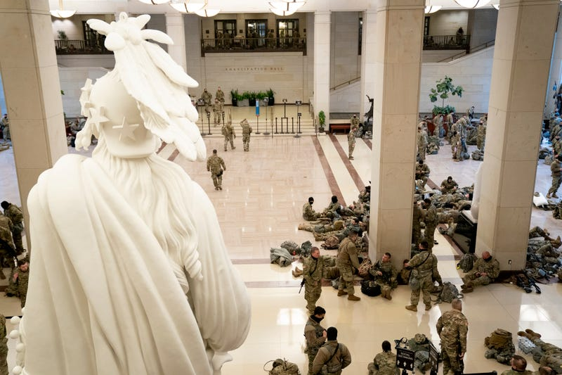 Members of the National Guard rest in the Visitor Center of the U.S. Capitol on January 13, 2021 in Washington, DC. Security has been increased throughout Washington following the breach of the U.S. Capitol last Wednesday, and leading up to the Presidential inauguration.