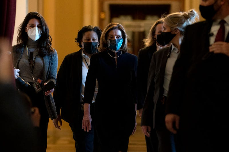 Speaker of the House Nancy Pelosi (D-CA) (C), surrounded by a security detail, walks to her office from the House Floor at the U.S. Capitol on January 13, 2021, in Washington, D.C.