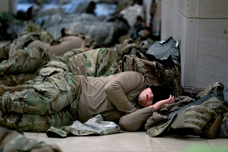 Members of the National Guard sleep in the U.S. Capitol on January 14, 2021 in Washington, DC. Security has been increased throughout Washington following the breach of the U.S. Capitol last Wednesday, and leading up to the Presidential Inauguration.