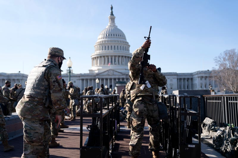 Members of the National Guard prepare to distribute weapons outside the U.S. Capitol on January 14, 2021 in Washington, DC. Security has been increased throughout Washington following the breach of the U.S. Capitol last Wednesday, and leading up to the Presidential Inauguration.