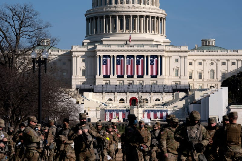 Members of the National Guard stand outside the U.S. Capitol on January 14, 2021 in Washington, DC. Security has been increased throughout Washington following the breach of the U.S. Capitol last Wednesday, and leading up to the Presidential Inauguration.