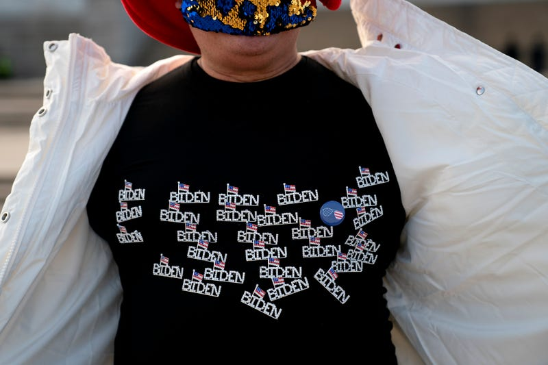 Kyriaki Chris, of Virginia, displays a Biden shirt while standing for a photo near the Lincoln Memorial on January 14, 2021 in Washington, DC. Due to security concerns, the National Mall will be closed on Inauguration Day, as people are encouraged to view inaugural events from their home.