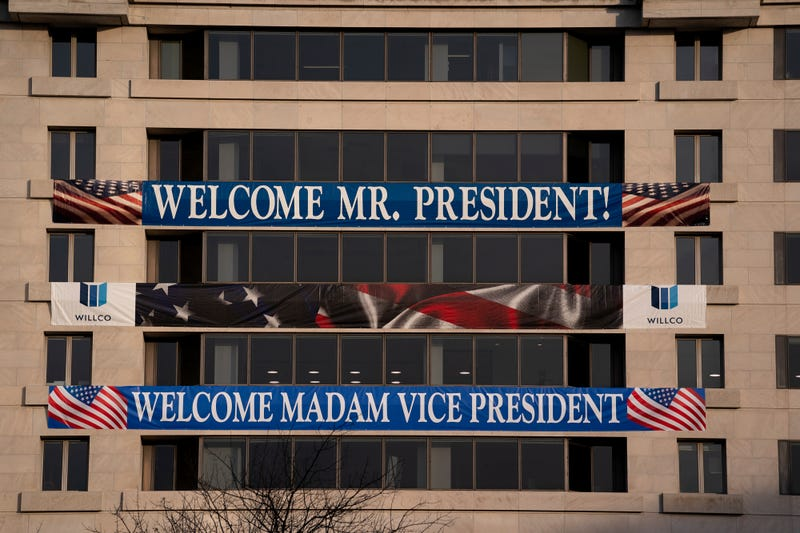 A sign welcoming the new President and Vice President is displayed on a building near Freedom Plaza on January 14, 2021 in Washington, DC. Security has been increased throughout Washington following the breach of the U.S. Capitol last Wednesday, and leading up to the Presidential Inauguration.