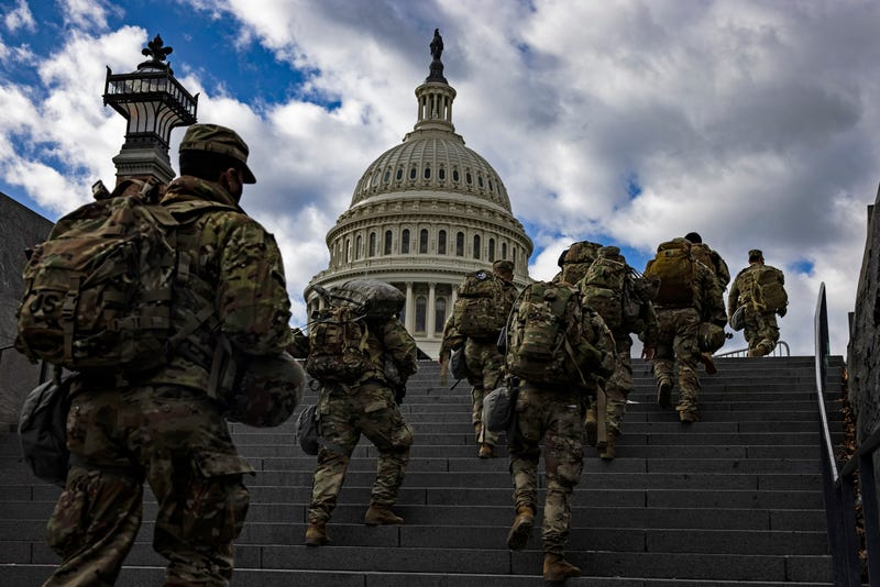 National Guard soldier head to the east front of the U.S. Capitol from the Capitol Visitors Center on January 17, 2021 in Washington, DC. After last week's riots at the U.S. Capitol Building, the FBI has warned of additional threats in the nation's capital and in all 50 states. According to reports, as many as 25,000 National Guard soldiers will be guarding the city as preparations are made for the inauguration of Joe Biden as the 46th U.S. President.