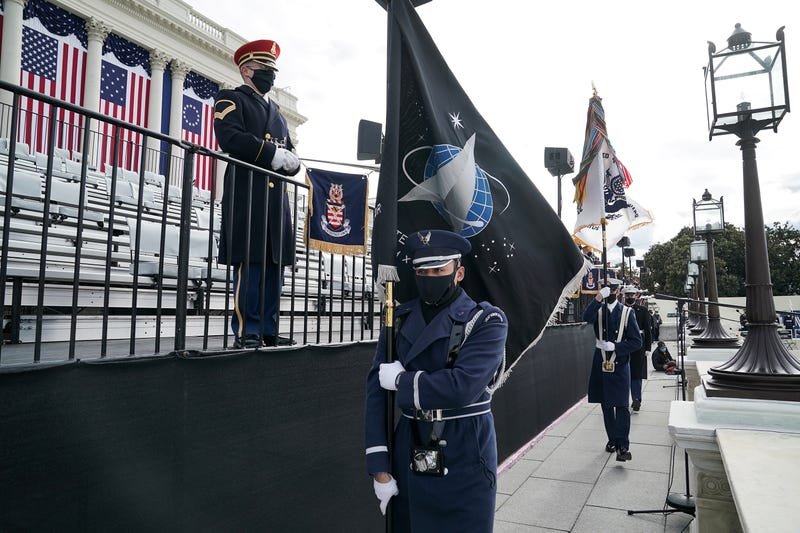 A member of the Air Force holds a Space Force flag in an honor guard during a dress rehearsal for the 59th inaugural ceremony for President-elect Joe Biden and Vice President-elect Kamala Harris at the U.S. Capitol on January 18, 2021 in Washington, DC.