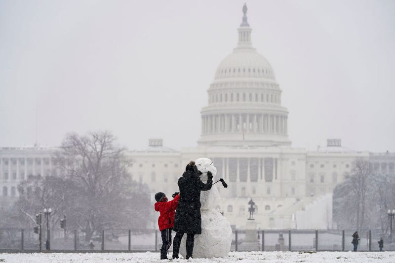 making a snowman at the National Mall