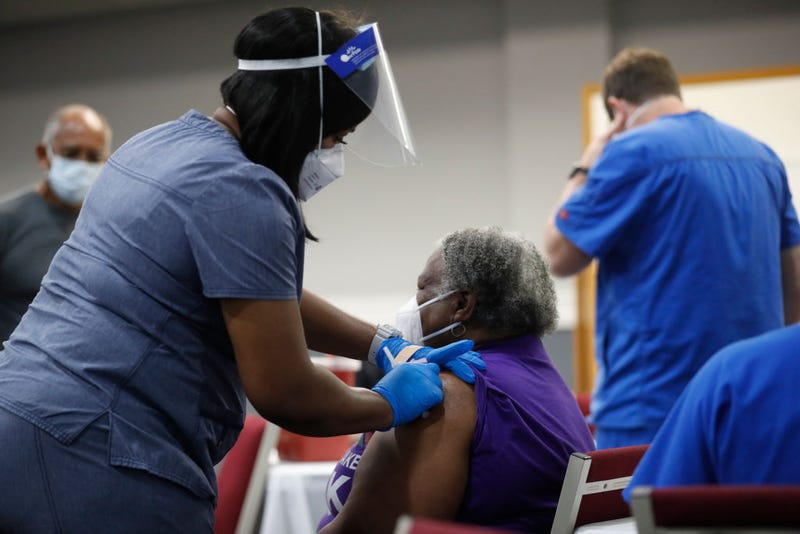 A community works to assist residents who are 65 and older to obtain the Covid-19 vaccine.