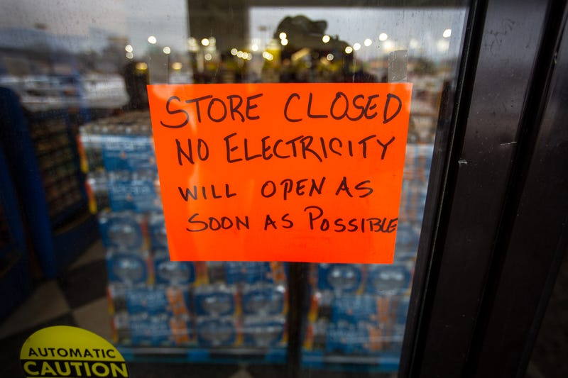 Winter Storm no electricity store closed sign