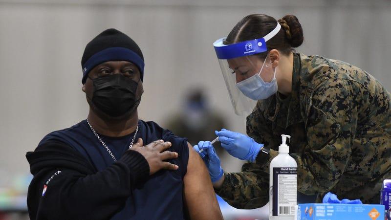 Someone receiving a coronavirus vaccine at the Pennsylvania Convention Center in Philadelphia.