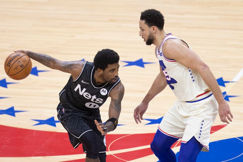 Nets star Kyrie Irving guarded by Sixers' Ben Simmons.