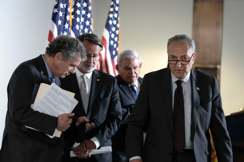 Sen. Sherrod Brown with Majority Leader Chuck Schumer and other Democrats.