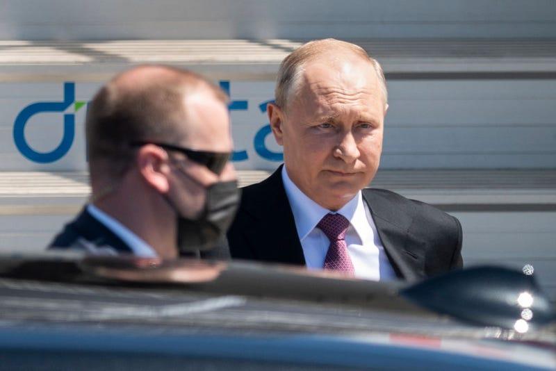 Russia's President Vladimir Putin disembarks from his plane on June 16, 2021, for the U.S.-Russia summit in Geneva.