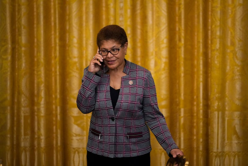 WASHINGTON, DC - JUNE 17: Rep. Karen Bass (D-CA) speaks on the phone before U.S. President Joe Biden signs the Juneteenth National Independence Day Act into law in the East Room of the White House on June 17, 2021 in Washington, DC. The Juneteenth holiday marks the end of slavery in the United States and the Juneteenth National Independence Day will become the 12th legal federal holiday — the first new one since Martin Luther King Jr. Day was signed into law in 1983. (Photo by Drew Angerer/Getty Images)