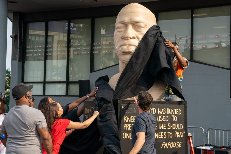 A statue of George Floyd is unveiled at Flatbush Junction on June 19, 2021, in the Brooklyn borough of New York City