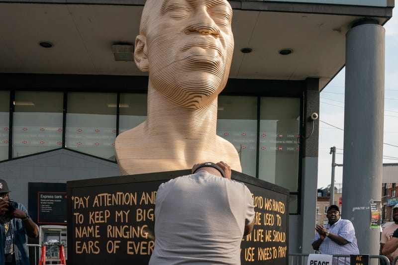 Terrance Floyd weeps during the unveiling of a statute dedicated to his brother George Floyd at Flatbush Junction on June 19, 2021, in the Brooklyn borough of New York City