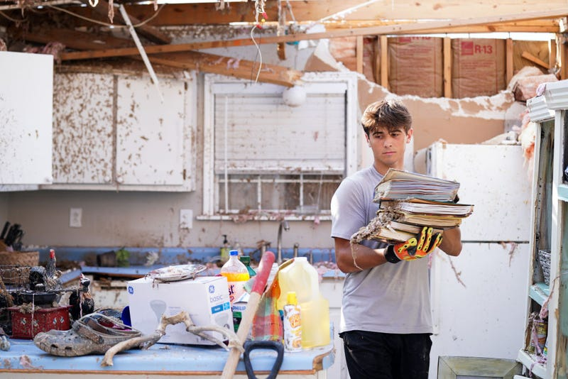 Michael Szeplaki helps to clean up his family's vacation house in the wake of Hurricane Ida on September 4, 2021 in Grand Isle, Louisiana. Ida made landfall as a Category 4 hurricane six days before in Louisiana and brought flooding, wind damage and power outages along the Gulf Coast. (Photo by Sean Rayford/Getty Images)