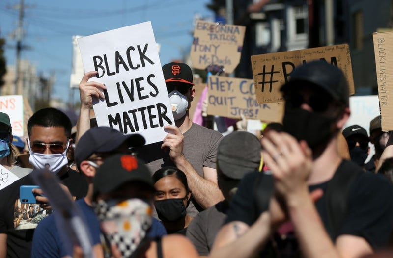 Protesters hold signs and chant during a demonstration to honor of George Floyd on June 03, 2020 in San Francisco, California.