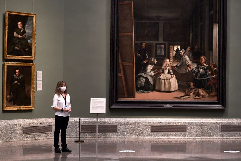 A museum worker wearing a face mask is seen next to Velazquez's 'Las Meninas' painting at the El Prado Museum during a press preview before its reopening to the public, during the coronavirus (COVID-19) pandemic on June 04, 2020 in Madrid, Spain. Spain has largely ended the lockdown it imposed to curb the spread of Covid-19, which caused the death of more than 27,000 people across the country.