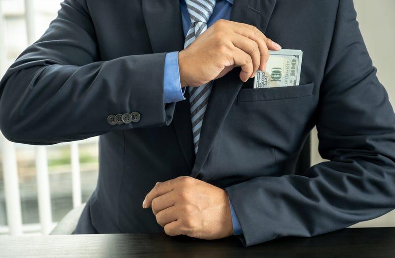 Guy Embezzling Money