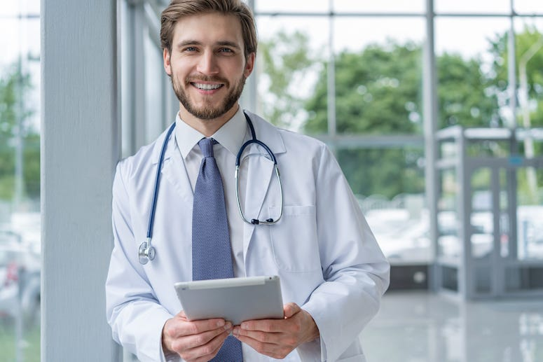 Male doctor using tablet in hospital