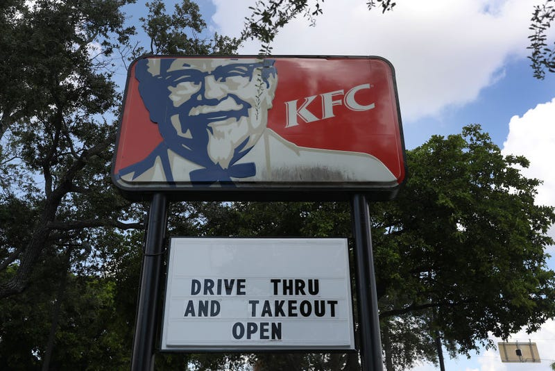 A KFC restaurant that closed its dining room and is only offering drive thru and takeout is seen on July 14, 2020 in Miami, Florida.
